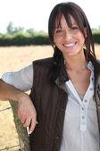 Portrait of a smiling woman farmer — Stock Photo