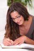 Woman writing in her diary — Stock Photo