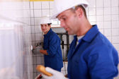 Two electricians indoors with tester — Stock Photo