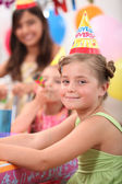 A little girl and her friends at a birthday party — Stock Photo