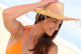 Portrait of a woman with straw hat — Stock Photo