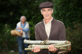 Man collecting wood — Stock Photo