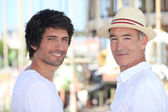 A 25 years old man and a 65 years old man in downtown, atmosphere sounds s — Stock Photo