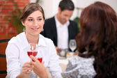 Women drinking wine in a restaurant — Stock Photo