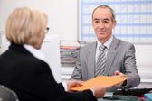 Businessman seeing a client — Stock Photo