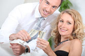 Couple drinking champagne together — Stock Photo