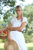 Blond woman collecting fruits — Stock Photo