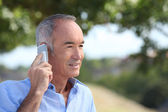Old man with a cellphone — Stock Photo