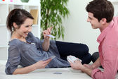 Young couple playing cards together — Stock Photo