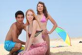 Teenagers on the beach — Stock Photo