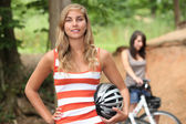 Teenage girls riding their bikes — Stockfoto
