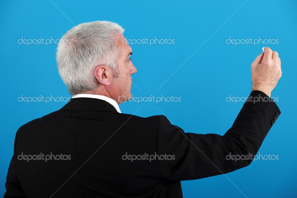 Businessman writing on an invisible board — Stock Photo #8015084