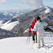 Adults standing in snow admiring landscape — Stock Photo
