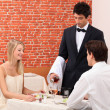 Waiter serving couple — Stockfoto #8029556