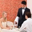 Waiter serving couple — Stock Photo
