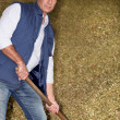 Man working in a barn - Stock Photo