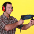 Man with a power drill — Stock Photo