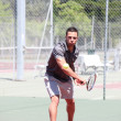 Tennis player in action — Stock Photo #8029943