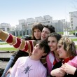 Group of teenagers hanging out on bench — Stock Photo #8030482