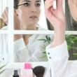 Woman applying make-up — Stock Photo