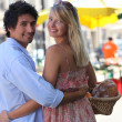Couple at an open air market — Stock Photo #8031291