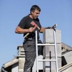 Tradesman building a chimney stack — Stock Photo