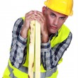 Woodworker with planks — Stock Photo #8031599