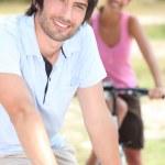 Couple riding bicycle — Stock Photo