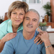 Mature couple sitting in the kitchen — Stock Photo #8032279