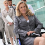 Successful businesswoman in wheelchair — Stock Photo