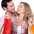 Couple with bags — Stock Photo #8032675