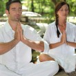 Couple meditating in stone garden — Stock Photo #8032731