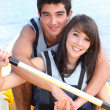Stock Photo: Young couple in paddle boat