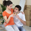 Celebration toast on moving day - Stock Photo