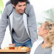 Stock Photo: A man bringing breakfast to his wife