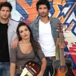 Three musician stood by graffiti — Stock Photo