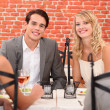 Two couples in a restaurant — Stock Photo