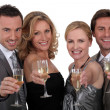 Stock Photo: Four toasting success