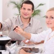 Stock Photo: Couple enjoying chocolate fondue