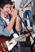 Man singing in a band — Stock Photo