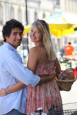 Couple at an open air market — Stock Photo