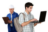 Old fashioned worker stood with teenager — Stock Photo