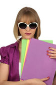Woman with files and oversized sunglasses — Stock Photo