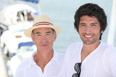 Father and grownup son at a marina — Stock Photo