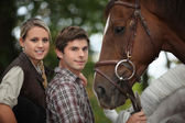 Two young and a horse — Stock Photo