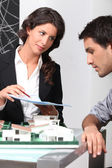 Estate agent and client discussing contracts — Stock Photo