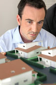 Architect staring at a model — Stock Photo