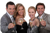 Four toasting success — Stock Photo