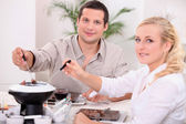 Couple enjoying a chocolate fondue — Stock Photo