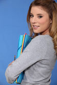 Young woman carrying folders — Stock Photo